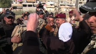 Download Iraqis in liberated Mosul district wave white flags Video