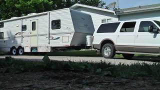 Download Backing 33' Trailer Up the Driveway with the Striaghtpiped Ford Powerstroke Diesel Excursion Video