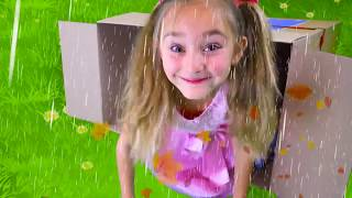 Download Sasha and Papa hiding from the rain in playhouses Video