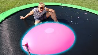 Download GIANT WATER BALLOON VS TRAMPOLINE!! Video