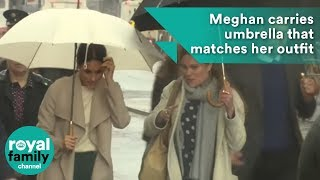 Download Meghan Markle carries umbrella that matches her outfit in Belfast rain Video