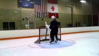 Download iPhones Survive Rapid-Fire Slap Shots in Shootout Against Legendary NHL Goalie Tim Thomas Video