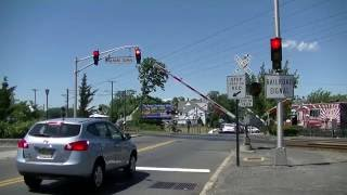 Download 2 NJ Transit Trains go through crossing with railroad preemption Video
