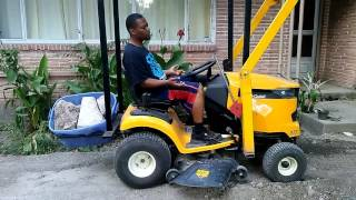 Download Riding lawn mower with front end loader Cub cadet XT1 Video