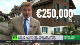 Download Refugee buy-out: Swiss village votes to pay fine to keep refugees out Video