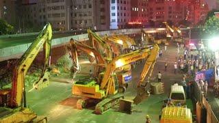 Download 100 Plus Excavators Dismantle Overpass Bridge in East China Video