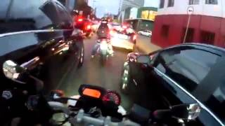 Download this crazy dude shows how to ride a motorbike during rush hour - WIN Video