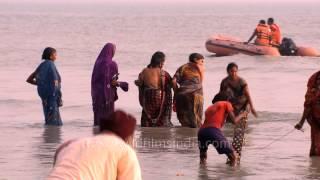 Download Thousands of people take Holy Dip during Makar Sankranti - Ganga Sagar Mela Video