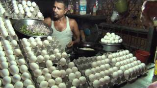 Download Man cooking Egg Omelette and giving it to customer on bread. Video
