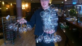 Download How to carry 24 wine glasses only one hand Video