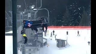 Download Dad Catches Son Falling From Ski Lift Video