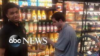 Download Worker lauded for inviting teen with autism to help him stock supermarket Video