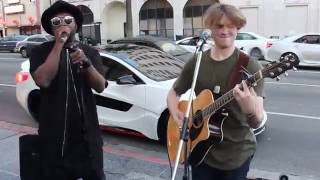 Download will.i.am surprises street performer Video