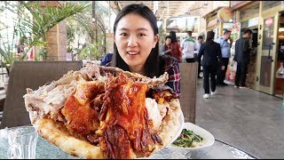 Download 在新疆吃烤全羊,2个饼包155元羊肉,真带劲!有顾客直接整只带走 Video