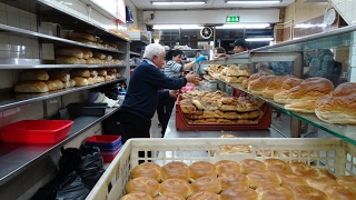 Download Master Bakers making 100's of bagels at World Famous 24 hour bakery: ″Beigel Bake″ Brick Lane London Video