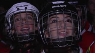 Download Local youth hockey players join Blackhawks on the ice Video