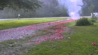 Download lighting off a 16,000 black cat firecracker roll Video
