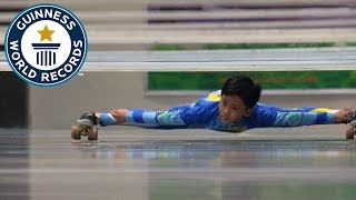 Download Farthest distance limbo skating under bars - Guinness World Records Video