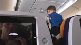 Download Child Screams For Most of 8-Hour Long Flight Video