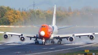 Download Orange BOEING 747 DEPARTURE on a WET RUNWAY (4K) Video