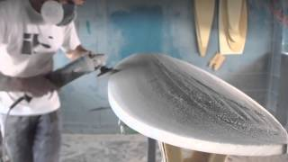 Download Hand shaping a surfboard from a blank Video