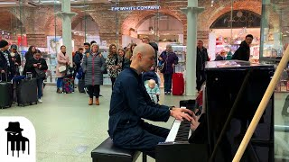 Download Disguised concert pianist stuns unsuspecting travelers Video