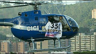Download Venezuelan police use stolen helicopter in attack on gov't buildings Video