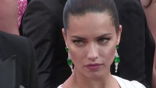 Download Adriana Lima stuns in white as she walk the red carpet for the Premiere of Julieta in Cannes Video