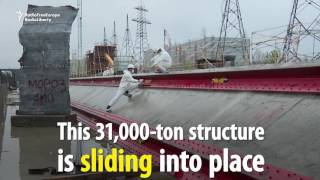 Download Chernobyl Containment Shield Begins Moving Into Place Video