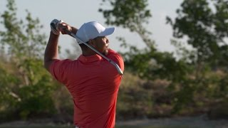 Download Tiger Woods warms up on the range Wednesday morning before Hero Video