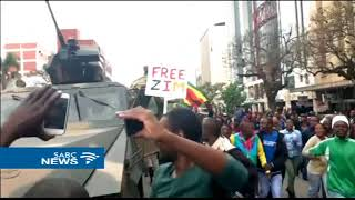Download Zimbabweans celebrate the expected fall of President Mugabe Video