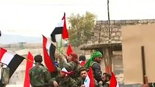 Download Cheers and posters of Assad greet Syrian militia fighters in Afrin Video