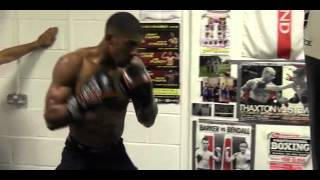 Download Anthony Joshua trains on the heavy bag, overseen by coach Tony Sims Video