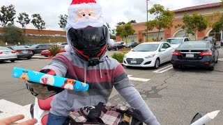 Download Motorcycle Santa Passes Out Christmas Presents Video
