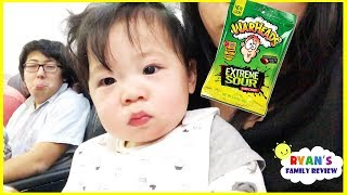 Download Twin Babies first airplane ride and Kid Warheads Sour Candy Challenge Video