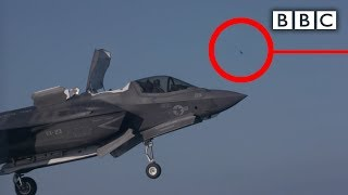 Download Tiny bird takes down most expensive fighter jet ever built - BBC Video