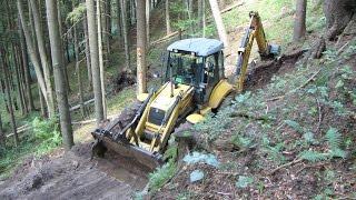 Download New Holland LB 115.B backhoe digging forest road II. Video
