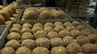 Download Laddoos of India and other diwali mithai being packed Video