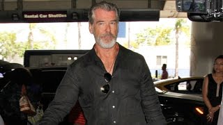 Download Pierce Brosnan Looking Exhausted At LAX After Late-Night Partying With Sting Video