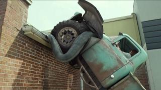 Download MONSTER TRUCK CHASE SCENE | DRIVING MONSTER TRUCK ON ROOFTOP SCENE FROM MONSTER TRUCKS IN REVERSE Video