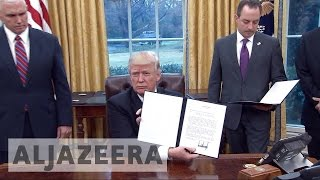 Download Trump withdraws US from TPP deal Video