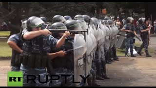 Download Argentina: Riot police fire rubber-bullets at protesters decrying public sector layoffs Video