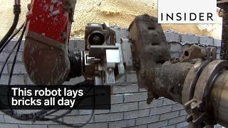 Download This robot lays bricks all day Video