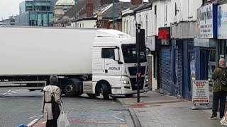 Download Lorry driver tries illegal U-Turn and blocks off road Video