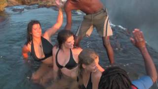 Download Girls unbelievable experience at Victoria Falls! Devil's Pool, Livingstone Island, Zambia Video