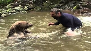 Download Mama Bear Does This after Man Saves Her Drowning Cubs Video