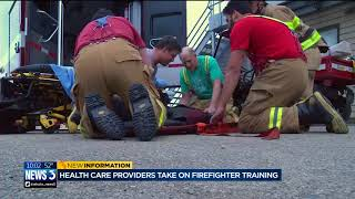 Download Health care providers take on firefighter training Video
