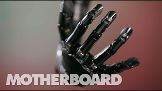 Download This Mind-Controlled Bionic Arm Can Touch and Feel Video