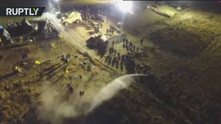 Download Drone dodges water cannon to capture DAPL protest Video