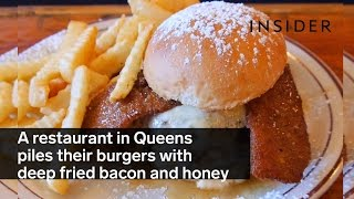 Download A restaurant in Queens piles their burgers with deep fried bacon and honey Video